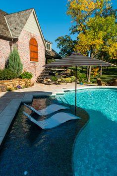 White Ledge Loungers on a pool tanning ledge