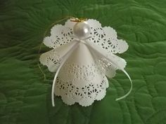 This is my original design. My three-dimensional delicate paper doily Angels are a lovely addition to any ornament collection. A gentle reminder of angels around us every day. They are made with care in my non smoking home. Their pearl heads and gold halos glisten over the double lacy bellowed skirt and sleeves. You can purchase one or several Angel ornaments to decorate your Christmas tree. They also make great package decorations and make wonderful party favors. For all year long, hang…