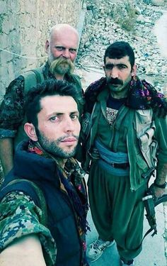kurdish and one european fighter in Shingal, protecting the yazidi community from ISIS