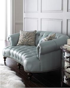 Blue leather sofa. love the shape, color, and depth (enough room to curl up). the pillows, not so much.