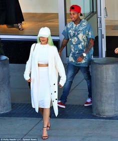 Attached at the hip: Kylie Jenner and Tyga were spotted running errands on Monday in Los A...