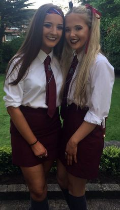 Girls Dressed In Formal School Uniforms With White Shirts And Red Ties