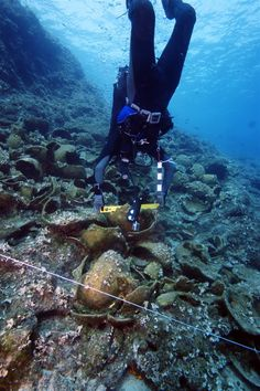 Diver on one of the 45 Ancient wrecks of fourni.korseai.com