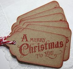 handmade Christmas tags from Dishfunctional Designs: Inspiration: Handmade Holiday Gift Tags ... kraft with red inking ... simple design with a Vintage look ...