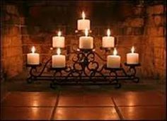 ...candles in the fireplace Another pin said add a plain mirror behind to add depth and reflect light