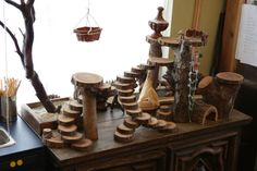 The Brooding Hen: Toy Tree House tutorial. Simple and creative idea using wood log rounds.