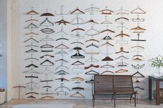 Antique coat hangers displayed as sculpture on large wall \\ Collected-by-Fritz-Karch-and-Rebecca-Robertson-Abrams-Remodelista-6