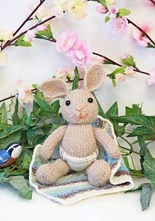 The bunny is knit from DK weight yarn, and the nappy and blanket are knit from fingering weight yarn. Knitted Bunnies, Baby Bunnies, Bunny, Crochet Amigurumi, Dk Weight Yarn, Dream Baby, Kids Playing, Mittens, Free Pattern
