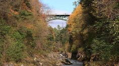 """The Quechee Gorge Bridge is the oldest standing steel arch bridge in Vermont. It was built in 1911 so that tracks for the Woodstock Railway could be carried over the gorge. Then in 1933, the bridge was converted for highway use. Today, the bridge is open to pedestrians looking to catch a breathtaking glimpse of the gorge -- a 165-foot-deep gap that locals call """"Vermont's Grand Canyon."""""""