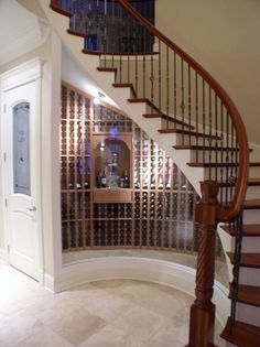 Transitional Wine Cellar with temperature regulated wine storage Under Stairs Wine Cellar, Wine Cellar Design, Stair Decor, Round House, Wine Storage, House Design, Wine Rooms, Wine Cellars, Cottage Ideas