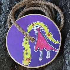 Ava's art comes to life once again on a tree swing!