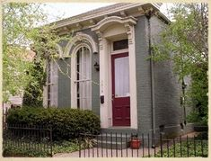 Shotgun style Italianate Cottage  Louisville - love the teal colour