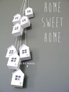 Home sweet home - Mooi hoe de huisjes zo bij elkaar hangen. Volgens mij zijn ze van karton gemaakt, maar dat weet ik niet zeker.