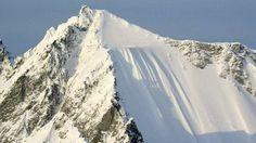 Skier tumbles down Alaska mountain - BBC News
