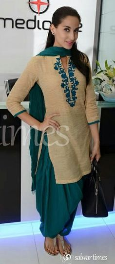cream designer 3/4th sleeves cotton kameez with 'V' shape collar neck pattern. Green embellished patch through out neck line. It is a green plain dupatta. Contrast with green patiala salwar.