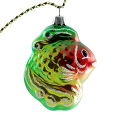 "This happy hand-painted fish figurine will be a great company to your Christmas ornaments collection. Each ornament is painted individually which makes them unique and adds some small variations to each product. Great gift to a child or an adult. Height: 3.1"" (78 mm). Made by skillful artists in Russia."