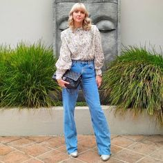 Printed blouse worn with flared jeans | Melissa Bult-Burns (@melissabultburns) | For more style inspiration visit 40plusstyle.com
