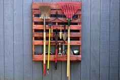 This easy, inexpensive project from HGTV Gardens upcycles a wooden pallet into a clever garden tool storage system.