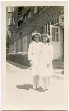 Two lovely nurses standing in front of a hospital, 1946.