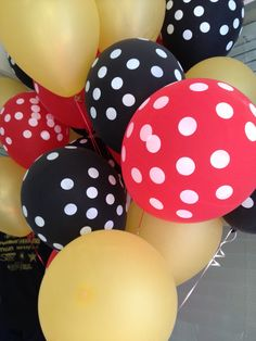 Minnie and Mickey Mouse birthday party! Gold, red, and black with polka dots