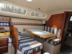 Catalina 25 Salon with Dinette Interior, Acordian Door To Head Sailboat Interior, Yacht Interior, Sailboat Decor, Acordian Doors, Sailboat Restoration, Small Yachts, Sailboat Living, Boat Projects, Best Boats