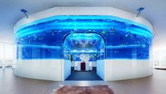 This amazing fish tank features a room in its centre and is the brainchild of James Bruce of Red Fin Aquarium Design, based in Hong Kong. Description from practicalfishkeeping.co.uk. I searched for this on bing.com/images