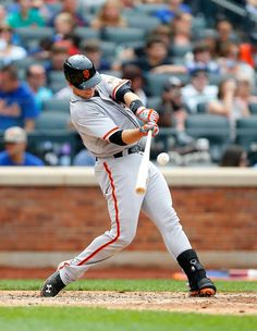 Buster Posey of the San Francisco Giants connects on a seventh inning two run home run against the New York Mets at Citi Field on August 3, 2014 in the Flushing neighborhood of the Queens borough of New York City.