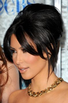 Kim Kardashian twists her hair into a Bardot-inspired bouffant for evening.
