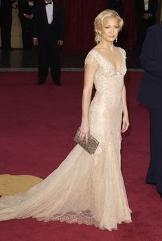 THIS is how you wear a nude-tone gown! Kate Hudson looks gorgeous in this Versace dress. She lets the dress speak for itself without too many accessories and lets her hair relax in a half up/half down 'do to compliment the relaxed shade of the gown.