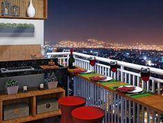 terrasse couverte avec des tabourets élégants en rouge et belle vue sur la ville en lumières