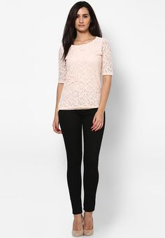 Define your winter vogue with the chic charm of this off-white coloured top from Dorothy Perkins. Styled with intricate floral lace detailing, this top promises sheer comfort too, courtesy its polycotton fabric.