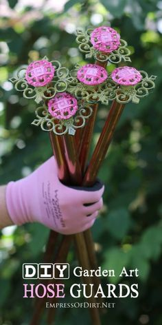 Garden hose or lawnmower cord dragging across your plants? Make homemade, repurposed hose guards for just a few dollars and save your p. Garden Art Diy, Amazing Gardens, Flower Garden, Diy Garden, Garden Design, Garden Landscaping, Garden Art, Yard Decor, Garden Projects