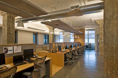Painted concrete ceiling, exposed columns, dropped lighting clouds, open plan Media Storm Office by DHD Architecture and Design Workspace Design, Office Interior Design, Office Interiors, Commercial Architecture, Interior Architecture, Light Paint Colors, Muted Colors, Exposed Ceilings, Contemporary Office