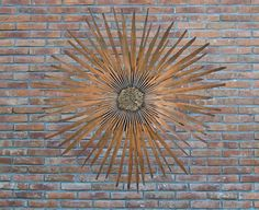 powerful outdoor wall art with sunshine shaped design inspiration for home exterior in brick wall decoration