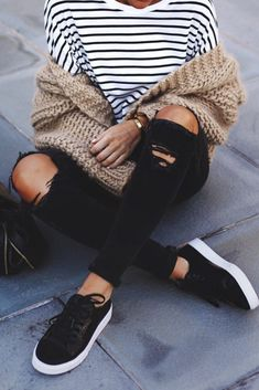 Stripes, ripped jeans, and sneakers.