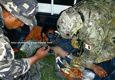 Incursore of Nono providing first aid to a wounded insurgent after a a firefight occurred against the detachment of Col Moschin which was involved in a joint activity with the Afghan forces.