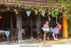 HOI AN, VIETNAM - MARCH 15, 2017: Group of people travel Hoian old town, ancient house, country heritage, city friendly with environment, walk, bicycle or pedicab on street, traveller visit at Vietnam