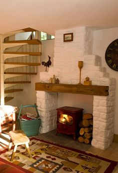 white painted brick behind wood burner fireplace but with a bigger and black burner