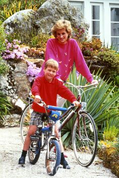 Diana, Princess of Wales with son Prince William, prepare for a cycling trip in Tresco during their holiday in the Scilly Isles.