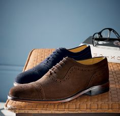 A blue and a brown Charles Tyrwhitt suede business shoe
