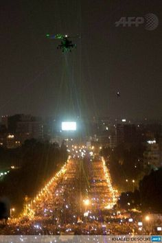 AH-64 Apache attack helicopter painted by green laser pointers during protests in Egypt...