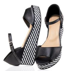 """Leatherlike upper with adjustable ankle strap. Straw-like wedge with easy-to-walk-on flat platform. Heel, 2"""" H.Half sizes, order one size up. www.youravon.com/jessicaworgo"""