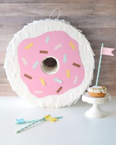 Make your own giant DIY donut piñata perfect for a donut themed party.