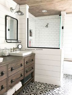 Completely DIY renovated master bathroom, DIY vanity (plans available via link on Instagram), shiplap, subway tile, walk in shower, planked ceiling