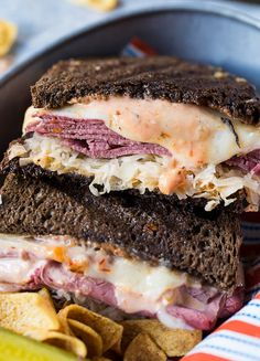 A traditional reuben sandwich with a little heat, these Spicy Reubens have a zesty sauce made from mayonnaise, chili sauce, horseradish, and cayenne pepper. Reuben Sandwich, Best Sandwich, Soup And Sandwich, Sandwich Recipes, Sandwich Box, Sandwich Ideas, Paninis, Quesadillas, Reuben Recipe