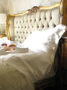 Versailles Upholstered Gold Luxury Bed, button backed upholstery, framed in antique gilt mahogany.