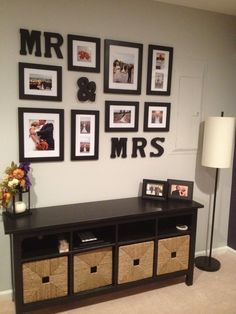 Display your wedding photos as a wall collage - This would look great with a personalized sign with names & wedding date on it - http://signsbyandrea.com/signs/first-names-wedding-date-sign