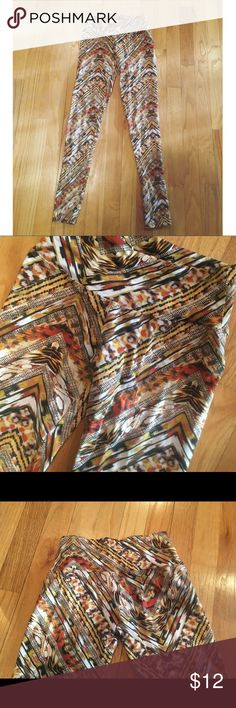 Patterned Yellow & Orange Colorful Yoga Leggings Yellow orange white brown colored leggings - Size Small - Runs Small  Great material for yoga / spin activites Pants Leggings