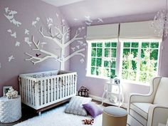 Tiffany Thiessen's celebrity nursery designed by Lonni Paul (check out the branch jutting out of the tree wall art that holds the mobile - so clever!)