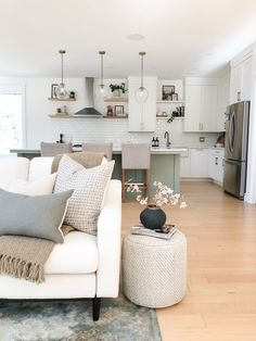 Get creative for side tables by using a stool, pouf or ottoman Casual Mom Style, Open Concept Home, Stone Flooring, Kitchen Design, Ottoman, Sweet Home, House Design, Living Room, Pillows